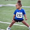 Kaileigh Patterson, 2, stretches during the kids track event at Manning Field on Tuesday, August 12. Kaileigh came in third place in the 3 years old and under race. Item Photo / Angela Owens.