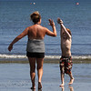 Erin Wetherell, left and her son Spencer Whetherell, right, on King's Beach in Lynn. Photo by Owen O'Rourke