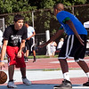 Liocar Terrero dribbles around Abraham Diaz during Part of the Solution's Summer Slam basketball tournament at the Warren Street Playground on Thursday, August 16. Item Photo / Angela Owens.