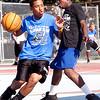 Juan Prenza dribbles around Adler Telfort during Part of the Solution's Summer Slam basketball tournament at the Warren Street Playground on Thursday, August 16. Item Photo / Angela Owens.