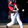 Marblehead's Ben McCarthy (9) swings during their game against Lynn in the Gallant Tournament at O'Grady Field in Salem on Thursday, August 16. Item Photo / Angela Owens.