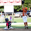 Marblehead's Henry Billings (5) slides into second while Lynn's Aeydon Leydon (2) jumps to make the catch during their game in the Gallant Tournament at O'Grady Field in Salem on Thursday, August 16. Item Photo / Angela Owens.