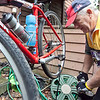 John Coulon, 60, pumps up one of the tires on his bike, at his home in Lynn on Wednesday, August 1. Coulon will be riding in his 20th Pan Mass Challenge this year. Item Photo / Angela Owens.