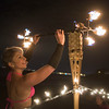 Sienna Moon performs a fire dance during the Hawaiian Barefoot beach party in Swampscott on Saturday, August 20, 2016. Photographer: Scott Eisen/The Item