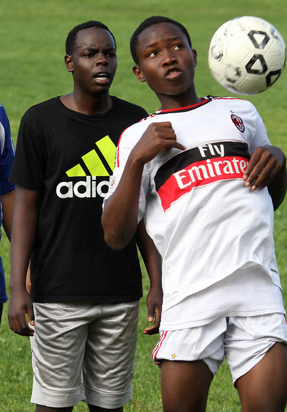 John Gathua, left, and Dominique Panmo during soccer practice at Lynn Classical High School on Saturday. Photo by Owen O'Rourke