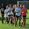 Running to stard soccer practice at Lynn Classical High School on Saturday Photo by Owen O'Rourke