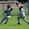 Jon Boldgett, left, and David Raggiero, right, go of a fly ball in left, Jon ended up cathing it. Photo Owen O'Rourke