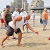 8/25/12  Revere,  Beach<br /> Bocce Tournament.  Dick Correggio, Revere, takes his turn as competitors watch.