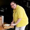 8/25/12.  Lynn. Cuffe-McGinn Funeral Home. Police/Fire Dept BBQ<br /> Mary Ellen Picardi, Peabody, prepares food for BBQ.