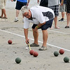 8/25/12  Revere,  Beach<br /> Bocce Tournament.  Referee ,Natale DeMarco, East Boston, measures distance of red ball from the white ball.