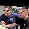 8/25/12 Lynn, Cuffe-McGinn Funeral Home. BBQ for police/fire departments.<br /> Kevin Brinkler and Chris Founcain, both Lynn firefighters enjoy the lunch.