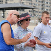 8/25/12  Revere,  Beach<br /> Bocce Tournament.  Bob Zolla, Stoneham, gives pointers to Carol Tye, Revere.  Jason Ruggiero, East Boston, on rt.