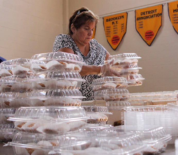 Ella Alexander prepares containers of finikia for the Grecian Festival at St. George Orthodox Church in Lynn this weekend. The festival begins on Friday at 6pm and runs until midnight, and resumes both Saturday and Sunday from noon until Midnight. Photo by Owen O'Rourke