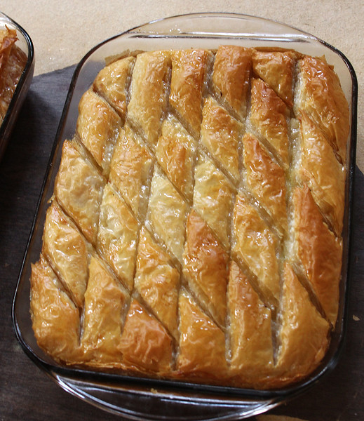 A pan of freshly made galaktoboureko that, along with many other baked goods, will be on sale at the annual Grecian Festival at St. George Orthodox Church in Lynn this weekend. The festival starts on Friday from 6pm until midnight, and resumes on both Saturday and Sunday from noon to midnight. Photo by Owen O'Rourke