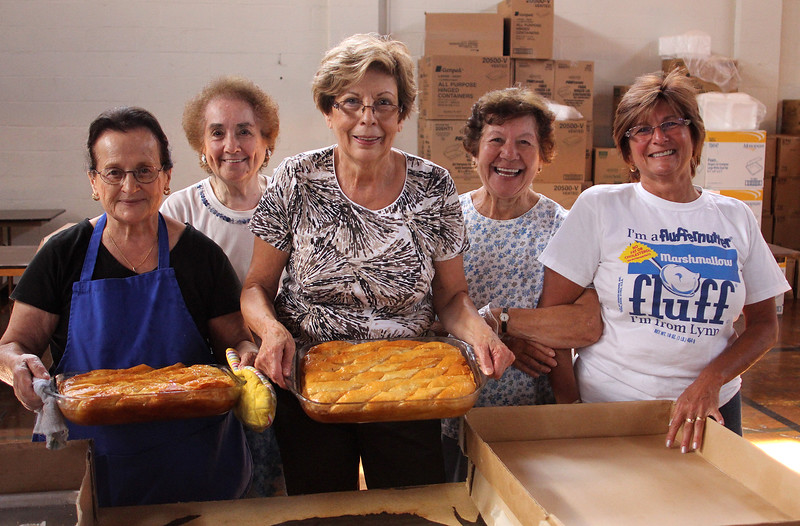 From left to right: Eleni Kadsoulomidis, Genie Scarmoutzos, Penny Kanellos, Connie Soteropoulos, and Maria Frangules Williams with freshly made galaktoboureko for sale at the Grecian Festival at St. George Orthodox Church across from Lynn common this weekend. The festival begins on Friday at 6pm and ends at midnight, and it resumes again on both Saturday and Sunday from noon  until midnight. Photo by Owen O'Rourke