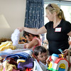 Marblehead.  Penny Bears Company/Charity.  Open house prior to moving the operation to Florida.<br /> Kelly Louzada, her son Joseph and daughter Kylie, Peabody, look over the many items available during the open house.