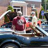 Marblehead. National Grand Bank parking lot.  Annul Car Show.  Doug Cummings of Lew Beach, NY looks at a 1969 Corvette.  He is visiting his brother Stuart ( in yellow t shirt) who lives in Marblehead.