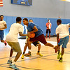 Lynn,Kipp Academy.  Program for kids.  Basketball.<br /> Javier Pimentel, aged 16, with ball.  Around him lft to rt: Elijah Nosa, Pius Roberts and unidentified player.