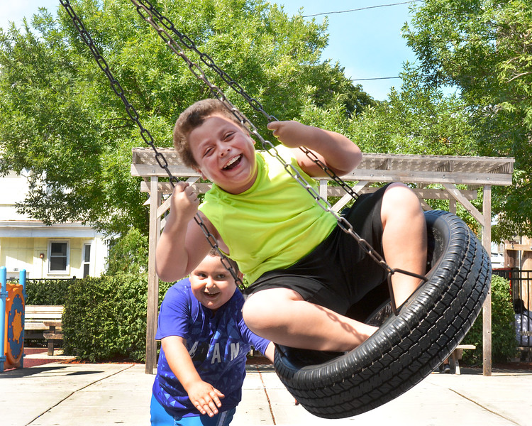 Revere, Costa Park on Shirley Ave.  <br /> Jorge Lemus enjoys the simple pleasures of being pushed high on the swing by his cousin Leo Lemus. Both Revere.