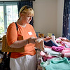 Marblehead.  Penny Bears Company/Charity.  Open house prior to moving the operation to Florida.<br /> Dara VanRemoortel, Marblehead, looks over items being offered during the open house.