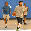 Lynn,Kipp Academy.  Program for kids.  Basketball.<br /> lft to rt: Abdoul Barry, Sopheara Chen with ball, and Fedsen Joseph.