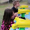 Max Collett and Chloe Kable play the Shark Attack squirt gun game at the fun day at the Lynn Special Needs Camp in Lynn Woods. Photo by Owen O'Rourke