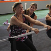 Susanne Lannon, left, and Michelle Nigro, right, the owner of Town Barre that is located in the Velocity Fitness building in Lynn, work on the chair pose during class. Photo by Owen O'Rourke