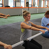 Michelle Nigro, left, the owner of Town Barre located in the Velocity Fitness building in Lynn, works on the chair pose with Alyssa VanVeghten, and Sheila Chandler, right. Photo by Owen O'Rourke