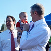 """Gov. Charlie Baker holds Joseph John Arrigo, Revere Mayor Brian Arrigo's son.  They are at the """"National Night Out"""" at the AC Whelan Elementary School, Revere.<br /> The event brings together police and members of the community."""