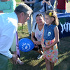 """Gov. Charlie Baker chats with Marie Frondulo and her family, Annabelle LeClair and Virginia LeClair (Virginia only partially shown on the lft) all of Revere. They are at the AC Whelan Elementary School in Revere for """"National Night Out""""."""