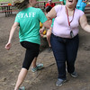Olivia Avery, left, and Dania Navarrete Carranza, right, dance to the music of a disc jockey at fun day at the Lynn Special Needs Camp in Lynn Woods. Photo by Owen O'Rourke