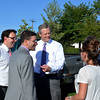 """Gov. Charlie Baker visits the """"National Night Out"""" event at the AC Whelan Elementary School in Revere. Lft to rt: Revere Mayor Brian Arrigo, Joe Gravellese,  Gov. Baker, Susan Gravellese and (mostly obscured Anthony Zambuto). The Gravelleses are from Revere."""