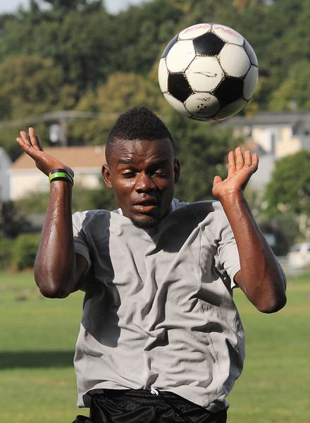 Lynn Classical soccer player Yabesi Musema practices ball drills at Hood Park today. Photo by Owen O'Rourke
