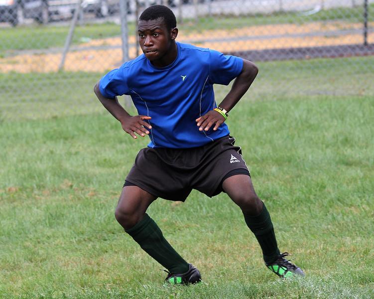 Lynn Classical High School soccer player Keregeya Nasibu shuffles sideways during a running drill at Hood Park today. Photo by Owen O'Rourke