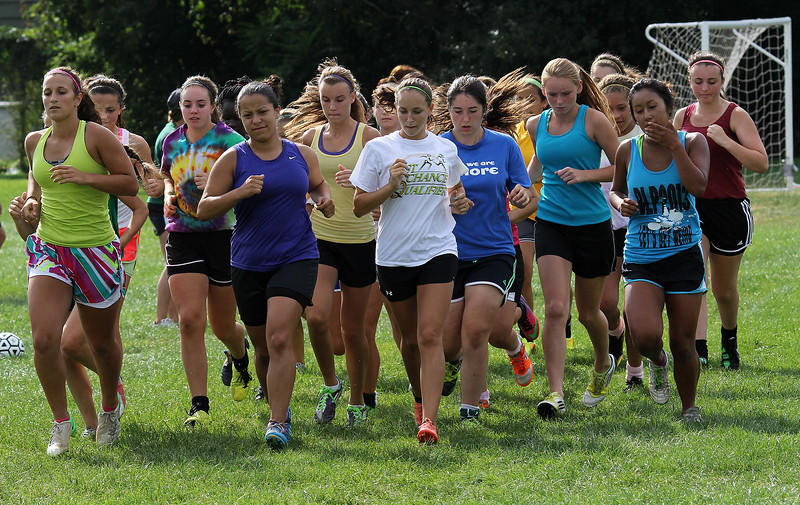 Members of the Lynn Classical High School girl's soccer team begin their one mile run during practice at Hood Park today. Photo by Owen O'Rourke