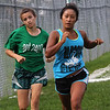 Devyn Astuccio, left, and Monica Meas, right, are the first two Lynn Classical High School soccer players to finish running a mile during practice at Hood Park today. Photo by Owen O'Rourke