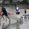 David Krauter, left, and Tony Roossien sprint to the finish line to win the grand pram race on Short Beach in Nahant on Saturday. Photo By Owen O'Rourke