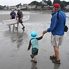 Caleb Conlin, left, and Dave Conllin, right, photograph the grand pram race on Short Beach in Nahant on Saturday. Photo by Owen O'Rourke