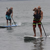 Phil Russell, left, came in a close second against the winner John Condon, right, in the paddle board race, one of five held at the grand pram race on Short Beach in Nahant on Saturday. Photo by Owen O'Rourke