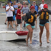 Amanda Szczawinski, left, and Lili Barba sprint to the water with their pram at the start of the sailing club race, the third of four, that took place at the grand pram race on Short Beach in Nahant on Saturday. Photo by Owen O'Rourke