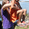 Kristen Kaneb lifts Briannys Fermin at the annual outing for Gril's Inc.kids at Nancy Whitman's house in Nahant today. This year's  event, sponsored by the Nahant Woman's Club, drew 170 people. Photo by  Owen O'Rourke