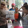 Nancy Whitman, left, holds a outing for Girl's Inc. kids every August, and this year she was given a gift of a signed hand made pillow from Yaris Guillen, Nicole Garcia and Illiana Reyna amoung others. This year 150 kids and 20 councilors showed up for the event. Photo by Owen O'Rourke