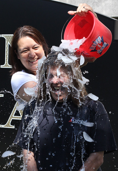 Chief of Staff Jamie Cerulli helps Mayor Judith Flanagan Kennedy complete the ice water challenge for ALS in front of Lynn City Hall today. Photo by Owen O'Rourke