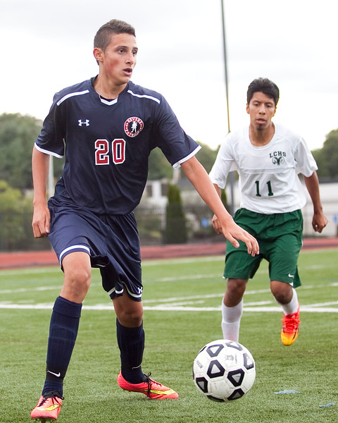 Revere's Steven Querubin (20) and Classical's Jesus Viveros (11) vie for the ball during their game at Manning Field on Tuesday, September 9. Item Photo / Angela Owens.