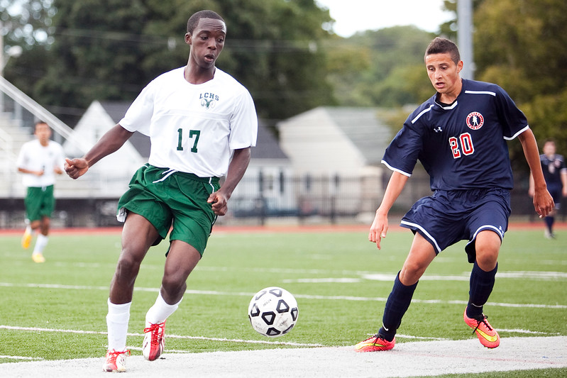 Classical's Peter Mafo (17) and Revere's Steven Querubin (20) vie for the ball during their game at Manning Field on Tuesday, September 9. Item Photo / Angela Owens.