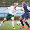 Classical's Andreas Dominovic (4) and Revere's Steven Querubin (20) vie for the ball during their game at Manning Field on Tuesday, September 9. Item Photo / Angela Owens.