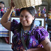 Martha Lobos brings supplies into the lobby at the Lynn City Hall for the Guatemala Independence day celebration.