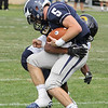 Swampscott's Devin Conroy is stopped by a player from St. Mary's in Saturday's game played in Swampscott. Photo by Owen O'Rourke