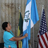 Reyna Mazariegos sets up the Guatemala day exhibit at Lynn City Hall today. Photo by Owen O'Rourke