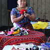 Martha Lopez assembles a table for Guatemala day at Lynn City Hall today. Photo by Owen O'Rourke